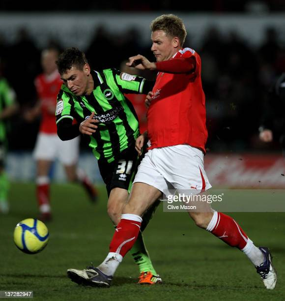 Jamie Tolley of Wrexham competes with Grant Hall of Brighton Hove Albion during the FA Cup Third Round Replay match between Wrexham and Brighton Hove...