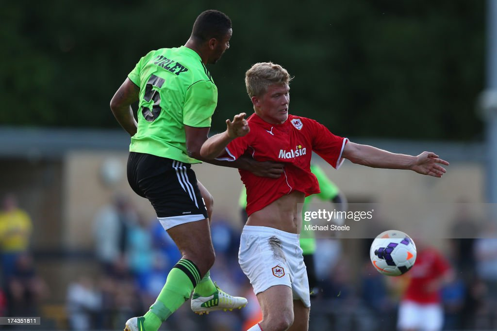 Jamie Turley of Forest Green challenges Andreas Cornelius of Cardiff City during the Pre Season Friendly match between Forest Green and Cardiff City...