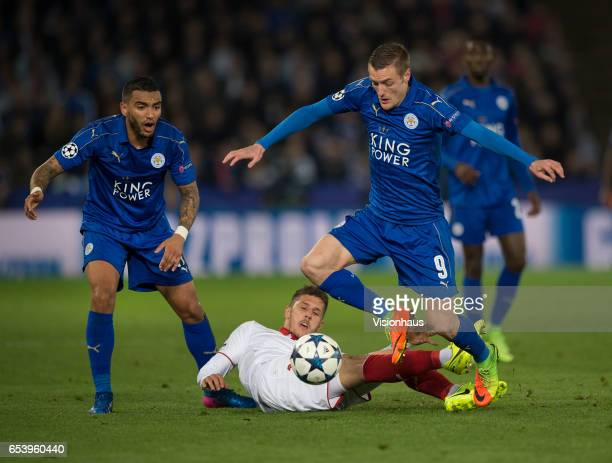 Jamie Vardy and Danny Simpson of Leicester City in action with Steven Jovetic of Sevilla FC on the floor during the UEFA Champions League Round of 16...