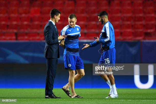 Jamie Vardy and Riyad Mahrez speak with Bartosz Kapustka of Leicester City before the UEFA Champions League Round of 16 first leg match between...