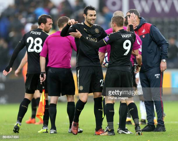 Jamie Vardy and Vicente Iborra of Leicester City celebrate after the final whistle of the Premier League match between Swansea City and Leicester...
