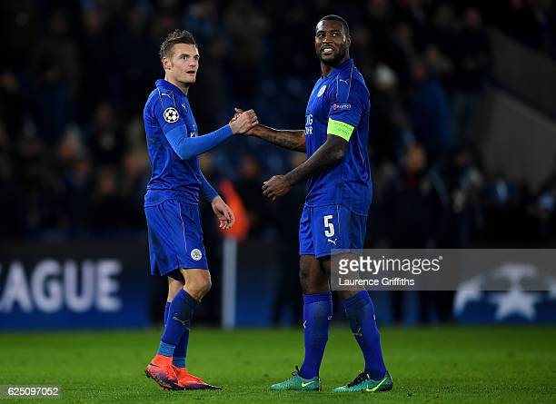 Jamie Vardy and Wes Morgan of Leicester City celebrate their teams 21 victory after the UEFA Champions League Group G match between Leicester City FC...
