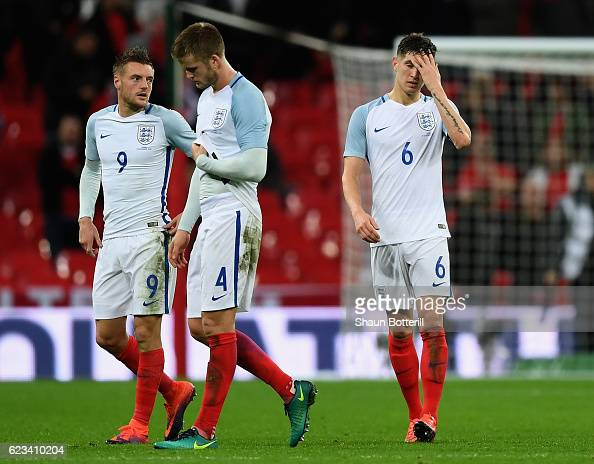 Jamie Vardy Eric Dier and John Stones of England react after the international friendly match between England and Spain at Wembley Stadium on...