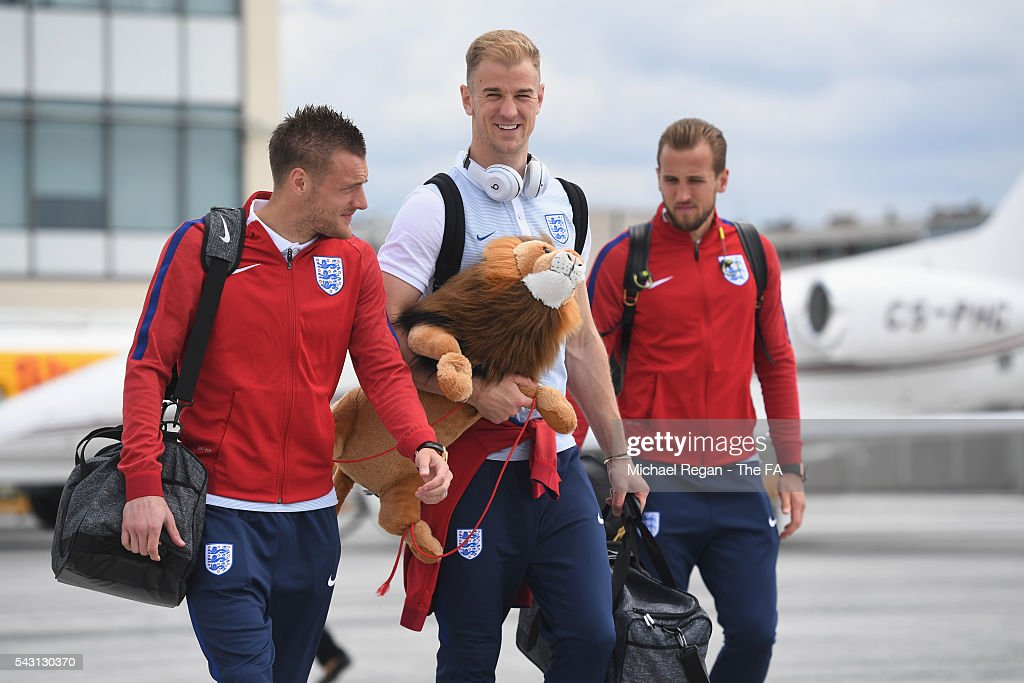 <a gi-track='captionPersonalityLinkClicked' href=/galleries/search?phrase=Jamie+Vardy&family=editorial&specificpeople=8695606 ng-click='$event.stopPropagation()'>Jamie Vardy</a>, <a gi-track='captionPersonalityLinkClicked' href=/galleries/search?phrase=Joe+Hart&family=editorial&specificpeople=1295472 ng-click='$event.stopPropagation()'>Joe Hart</a> and <a gi-track='captionPersonalityLinkClicked' href=/galleries/search?phrase=Harry+Kane+-+Soccer+Player&family=editorial&specificpeople=13636610 ng-click='$event.stopPropagation()'>Harry Kane</a> look on as the England team board the flight to Nice on June 26, 2016 in Paris, France.