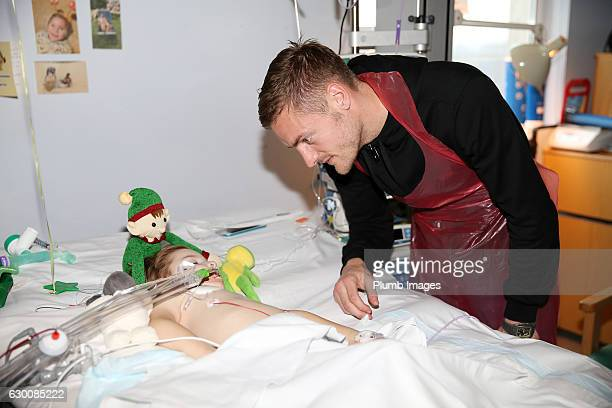 Jamie Vardy meets a sleeping patient as they deliver Christmas presents to patients at Leicester Royal Infirmary on December 15 2016 in Leicester...