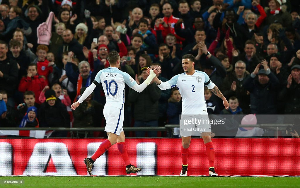 <a gi-track='captionPersonalityLinkClicked' href=/galleries/search?phrase=Jamie+Vardy&family=editorial&specificpeople=8695606 ng-click='$event.stopPropagation()'>Jamie Vardy</a> (l) of England celebrates scoring the opening goal with <a gi-track='captionPersonalityLinkClicked' href=/galleries/search?phrase=Kyle+Walker&family=editorial&specificpeople=5609702 ng-click='$event.stopPropagation()'>Kyle Walker</a> during the International Friendly match between England and Netherlands at Wembley Stadium on March 29, 2016 in London, England.