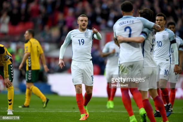 Jamie Vardy of England celebrates with his team mates after scoring his side's second goal during the FIFA 2018 World Cup Qualifier between England...
