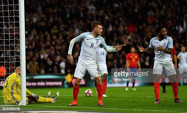 Jamie Vardy of England celebrates with Raheem Sterling as he scores their second goal during the international friendly match between England and...