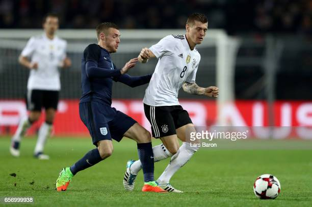 Jamie Vardy of England challenges Toni Kroos of Germany during the international friendly match between Germany and England at Signal Iduna Park on...