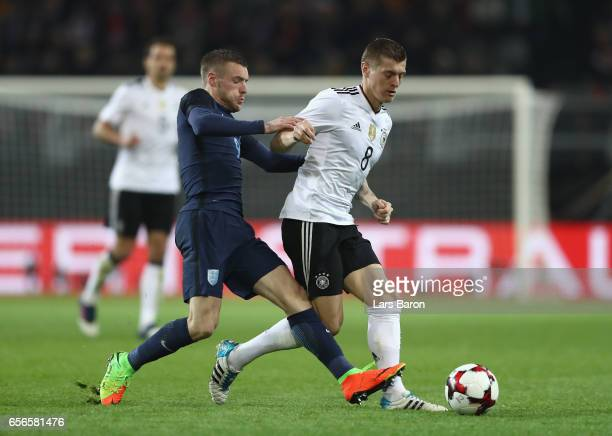 Jamie Vardy of England closes down Toni Kroos of Germany during the international friendly match between Germany and England at Signal Iduna Park on...