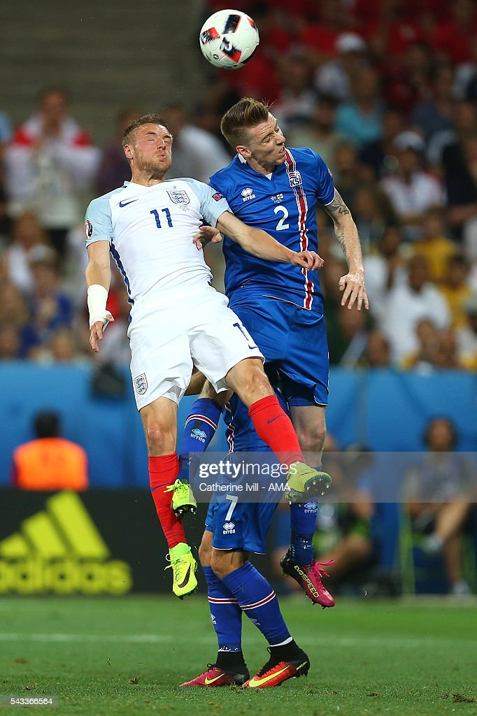 Jamie Vardy of England competes with Birkir Saevarsson pf Iceland during the UEFA Euro 2016 Round of 16 match between England and Iceland at Allianz Riviera Stadium on June 27, 2016 in Nice, France.