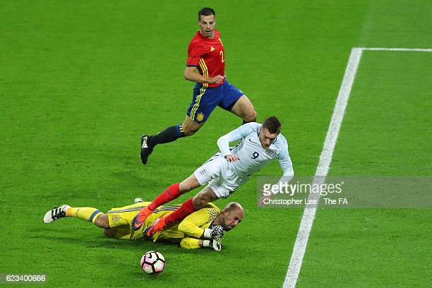 Jamie Vardy of England is brought dow by goalkeeper Pepe Reina of Spain to concede a penalty during the international friendly match between England...