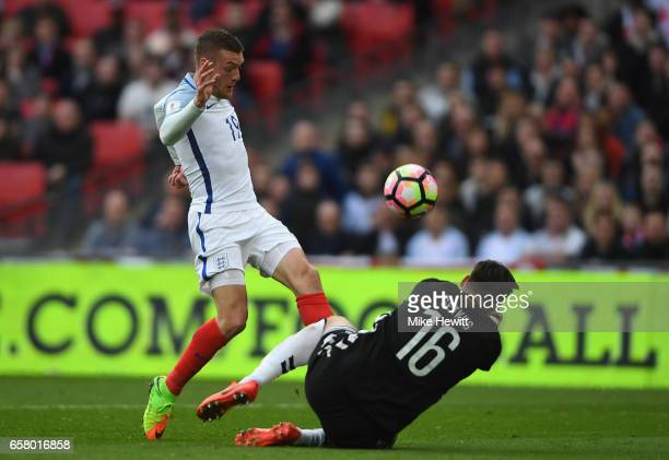 Jamie Vardy of England is closed down by Ernestas Setkus of Lithuania during the FIFA 2018 World Cup Qualifier between England and Lithuania at...