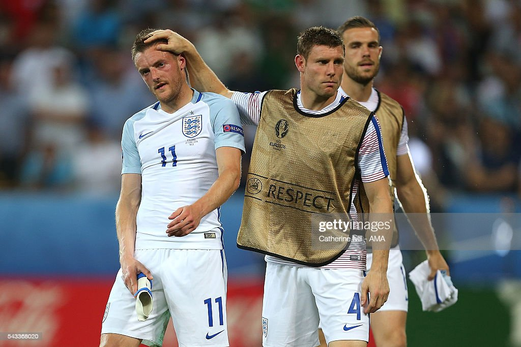 <a gi-track='captionPersonalityLinkClicked' href=/galleries/search?phrase=Jamie+Vardy&family=editorial&specificpeople=8695606 ng-click='$event.stopPropagation()'>Jamie Vardy</a> of England is consoled by <a gi-track='captionPersonalityLinkClicked' href=/galleries/search?phrase=James+Milner+-+Soccer+Player&family=editorial&specificpeople=214576 ng-click='$event.stopPropagation()'>James Milner</a> at the end of the UEFA Euro 2016 Round of 16 match between England and Iceland at Allianz Riviera Stadium on June 27, 2016 in Nice, France.