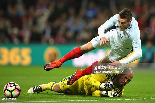 Jamie Vardy of England isbrought dow by goalkeeper Pepe Reina of Spain to concede a penalty during the international friendly match between England...