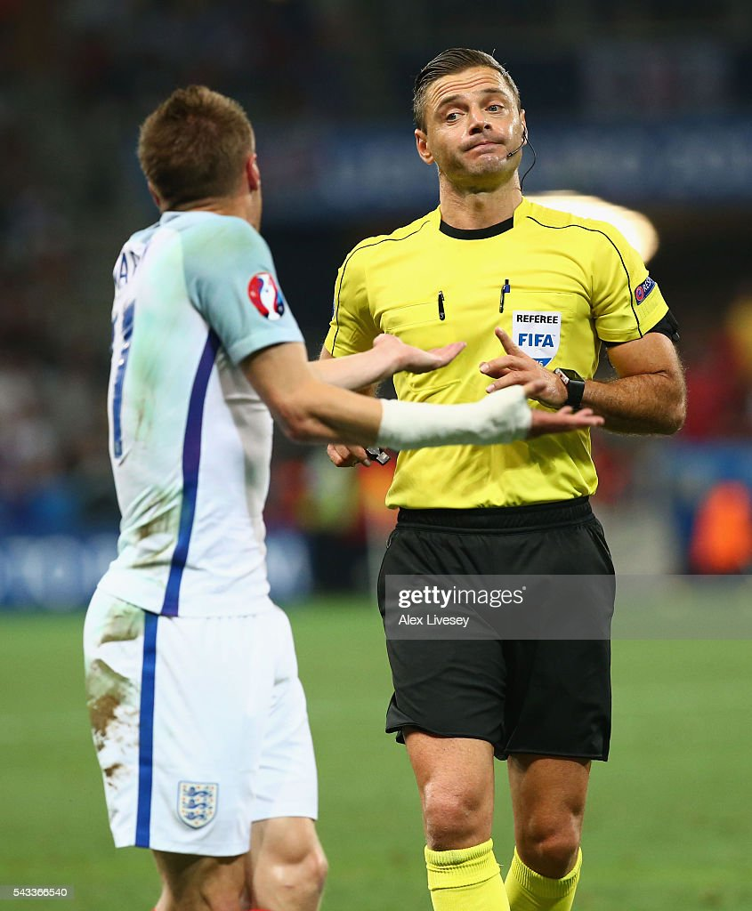 Jamie Vardy of England protests to referee Damir Skomina during the UEFA EURO 2016 round of 16 match between England and Iceland at Allianz Riviera Stadium on June 27, 2016 in Nice, France.