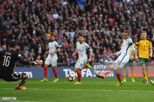Jamie Vardy of England scores his side's second goal past Ernestas Setkus of Lithuania during the FIFA 2018 World Cup Qualifier between England and...
