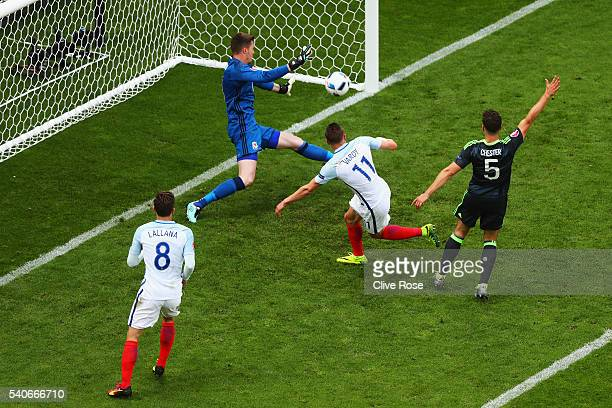 Jamie Vardy of England scores his team's first goal during the UEFA EURO 2016 Group B match between England and Wales at Stade BollaertDelelis on...