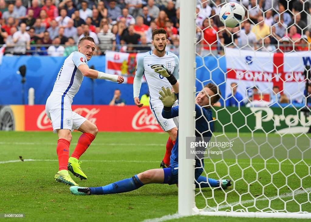 Jamie Vardy (R) of England scores his team's first goal past Wayne Hennessey of Wales during the UEFA EURO 2016 Group B match between England and Wales at Stade Bollaert-Delelis on June 16, 2016 in Lens, France.