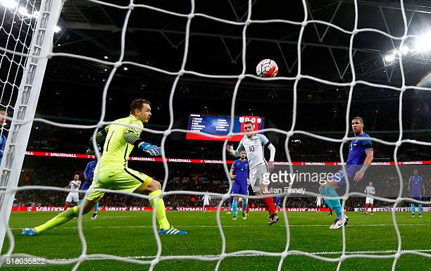 Jamie Vardy of England scores the opening goal past Jeroen Zoet goalkeeper of the Netherlands during the International Friendly match between England...