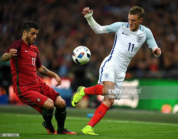Jamie Vardy of England takes on Vieirinha of Portugal during the international friendly match between England and Portugal at Wembley Stadium on June...