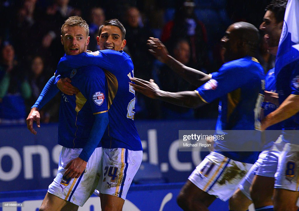 Jamie Vardy (L) of Leicester celebrates scoring to make it 4-1 with team mates during the Sky Bet Championship match between Leicester City and Derby County at The King Power Stadium on January 10, 2014 in Leicester, England.