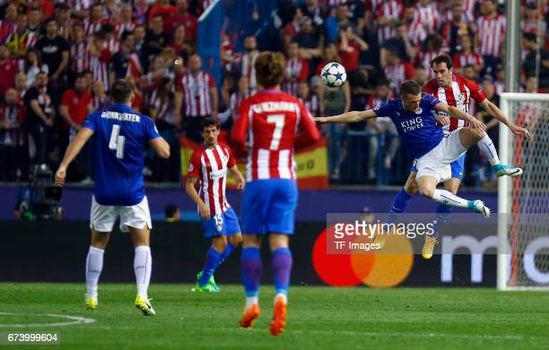 Jamie Vardy of Leicester City and Diego Godin of Atletico Madrid battle for the ball during the UEFA Champions League Quarter Final first leg match...