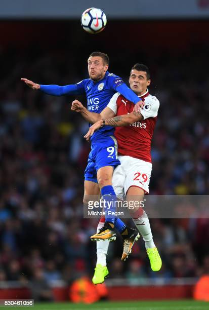 Jamie Vardy of Leicester City and Granit Xhaka of Arsenal compete for a header during the Premier League match between Arsenal and Leicester City at...