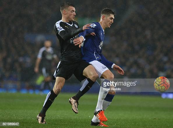 Jamie Vardy of Leicester City and John Stones of Everton compete for the ball during the Barclays Premier League match between Everton and Leicester...