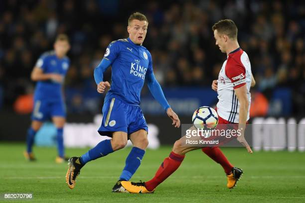 Jamie Vardy of Leicester City and Jonny Evans of West Bromwich Albion in action during the Premier League match between Leicester City and West...