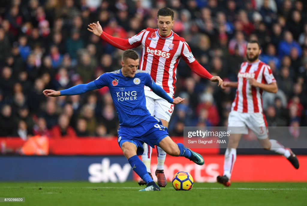 Jamie Vardy of Leicester City and Kevin Wimmer of Stoke City during the Premier League match between Stoke City and Leicester City at Bet365 Stadium on November 4, 2017 in Stoke on Trent, England.