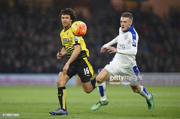 Jamie Vardy of Leicester City and Nathan Ake of Watford compete for the ball during the Barclays Premier League match between Watford and Leicester...