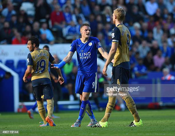 Jamie Vardy of Leicester City and Per Mertesacker of Arsenal argue during the Barclays Premier League match between Leicester City and Arsenal at The...