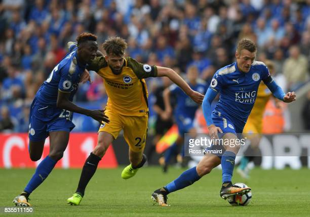 Jamie Vardy of Leicester City battle for possession with Davy Propper of Brighton and Hove Albion during the Premier League match between Leicester...