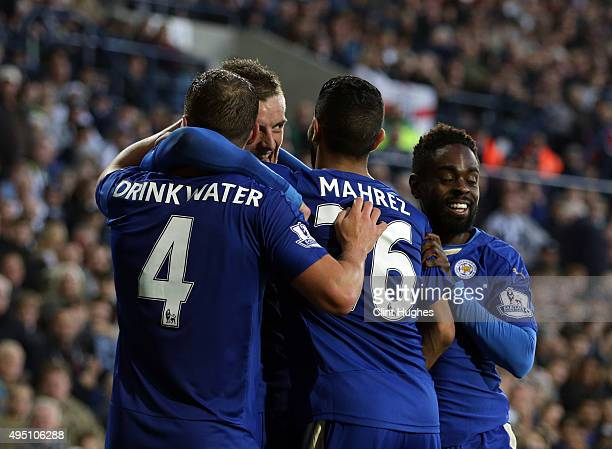 Jamie Vardy of Leicester City celebrates after he scores the third goal of the game for his side with teammates Danny Drinkwater Riyad Mahrez and...