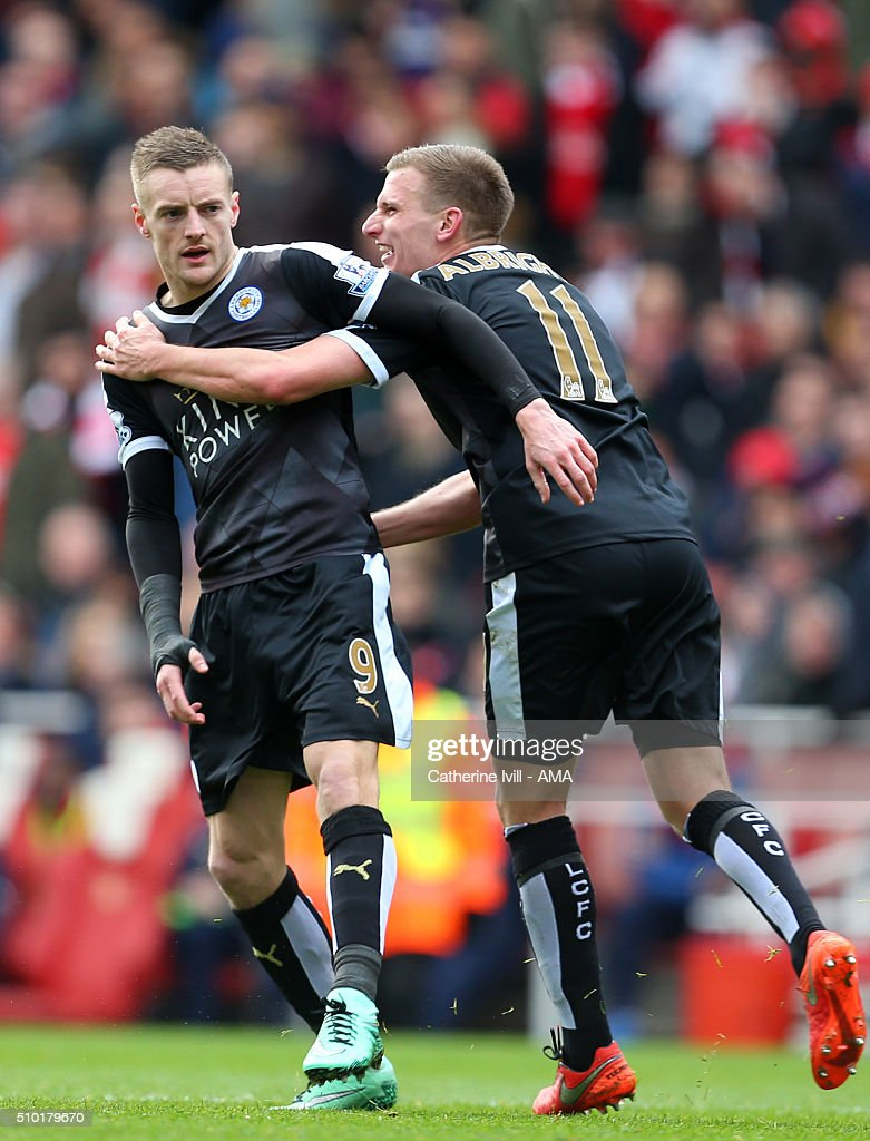 Jamie Vardy of Leicester City celebrates after he scores to make it 0-1 with Marc Albrighton of Leicester City during the Barclays Premier League match between Arsenal and Leicester City at the Emirates Stadium on February 14, 2016 in London, England.