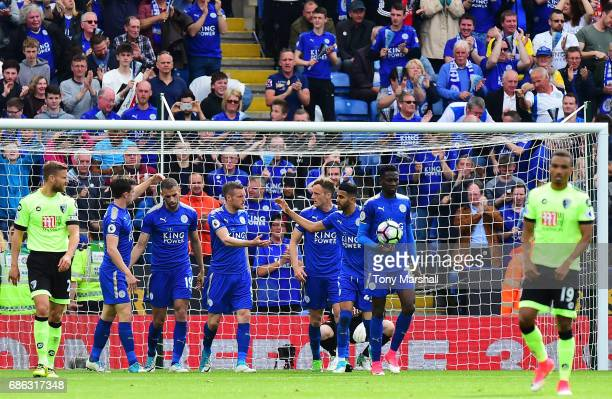 Jamie Vardy of Leicester City celebrates scoring his sides first goal with his Leicester City team mates during the Premier League match between...