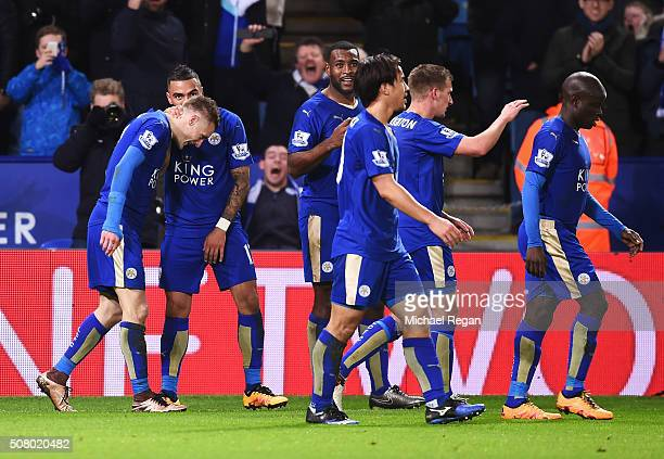 Jamie Vardy of Leicester City celebrates scoring his team's first goal with his team mates during the Barclays Premier League match between Leicester...