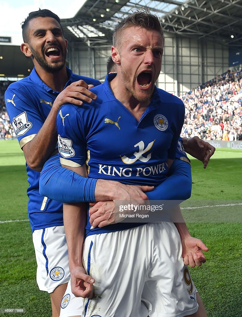 Jamie Vardy of Leicester City celebrates scoring their third goal with team mates during the Barclays Premier League match between West Bromwich Albion and Leicester City at The Hawthorns on April 11, 2015 in West Bromwich, England.