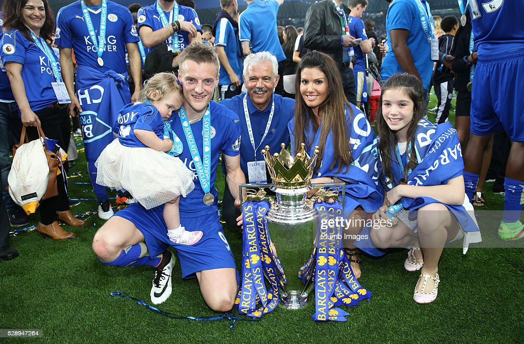Jamie Vardy of Leicester City celebrates with his fiancee Rebekah Nicholson and family with the Premier League trophy at the King Power Stadium on May 7th , 2016 in Leicester, United Kingdom.