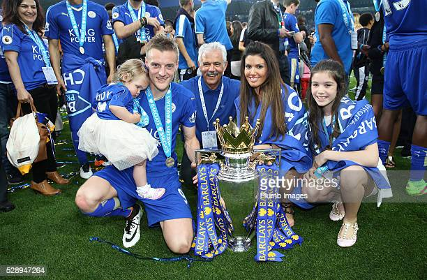 Jamie Vardy of Leicester City celebrates with his fiancee Rebekah Nicholson and family with the Premier League trophy at the King Power Stadium on...