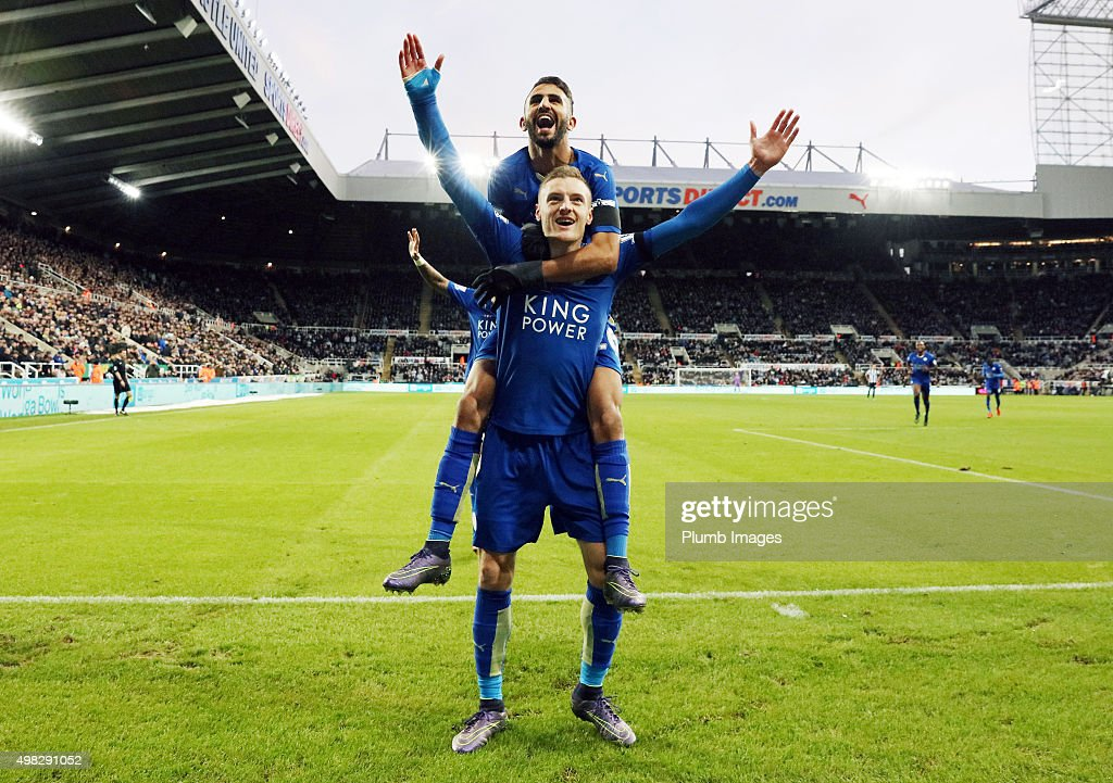 Jamie Vardy of Leicester City celebrates with Riyad Mahrez of Leicester City after scoring to equal Ruud Van Nistelrooy's record of scoring in 10 consecutive Premier League matches during the Premier League match between Newcastle United and Leicester City at St. James' Park on November 21, 2015 in Newcastle upon Tyne , United Kingdom.