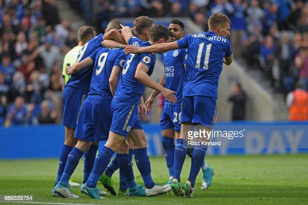 Jamie Vardy of Leicester City celebrates with team mates after scoring his sides first goal during the Premier League match between Leicester City...