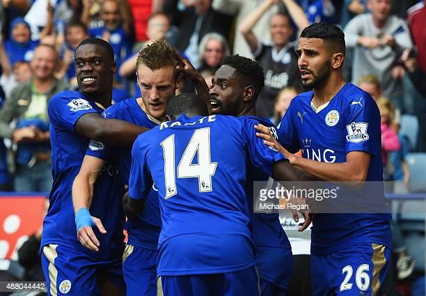 Jamie Vardy of Leicester City celebrates with team mates as he scores their second and equalising goal during the Barclays Premier League match...