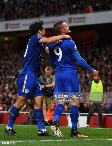 Jamie Vardy of Leicester City celebrates with teammate Shinji Okazaki of Leicester City after scoring his team's second goal during the Premier...
