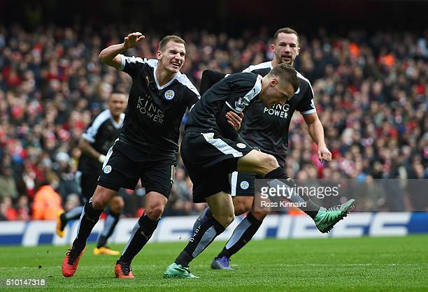 Jamie Vardy of Leicester City celebrates with teammates after scoring the opening goal from the penalty spot during the Barclays Premier League match...
