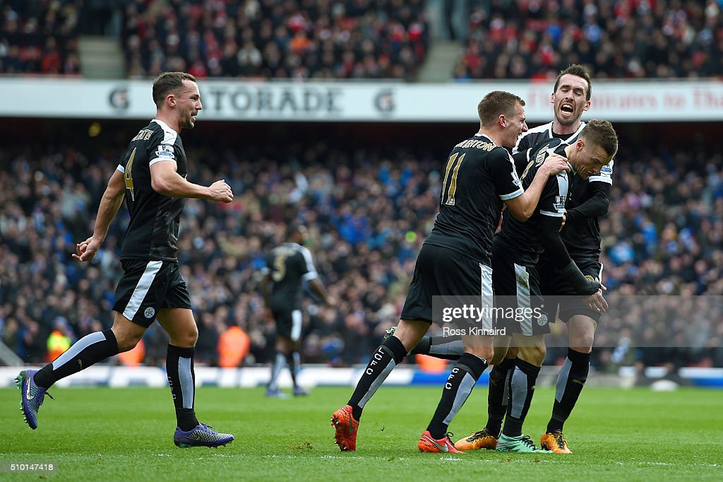 <a gi-track='captionPersonalityLinkClicked' href=/galleries/search?phrase=Jamie+Vardy&family=editorial&specificpeople=8695606 ng-click='$event.stopPropagation()'>Jamie Vardy</a> of Leicester City celebrates with team-mates after scoring the opening goal from the penalty spot during the Barclays Premier League match between Arsenal and Leicester City at Emirates Stadium on February 14, 2016 in London, England.