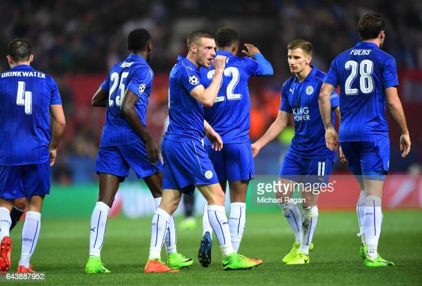 Jamie Vardy of Leicester City celebrates with teammates after scoring his side's first goal during the UEFA Champions League Round of 16 first leg...