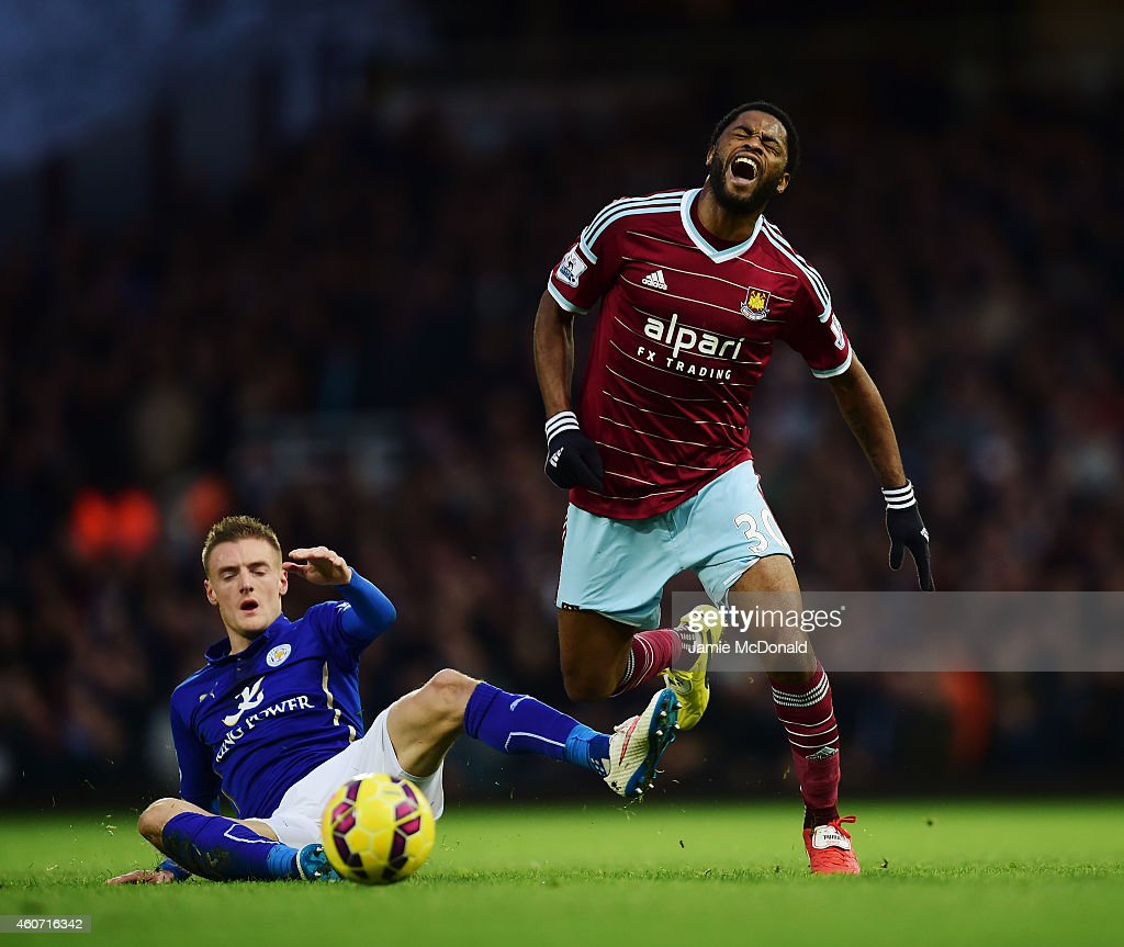 Jamie Vardy of Leicester City challenges Alexandre Song of West Ham (R) during the Barclays Premier League match between West Ham United and Leicester City at Boleyn Ground on December 20, 2014 in London, England.