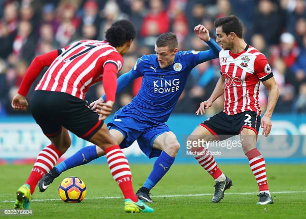 Jamie Vardy of Leicester City competes for the ball against Cedric Soares and Virgil van Dijk of Southampton compete for the ball during the Premier...